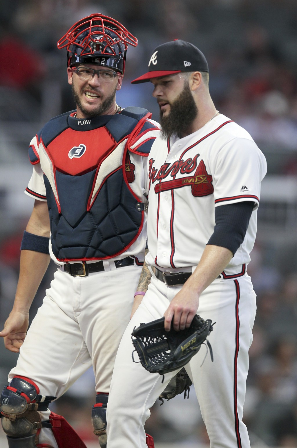 Atlanta Braves starting pitcher Dallas Keuchel, right, leaves the field as he talks to catcher Tyler Flowers during the fifth inning of a baseball gam...