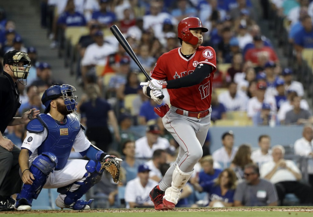 Los Angeles Angels' Shohei Ohtani drives in a run with a single during the second inning of a baseball game against the Los Angeles Dodgers Tuesday, J