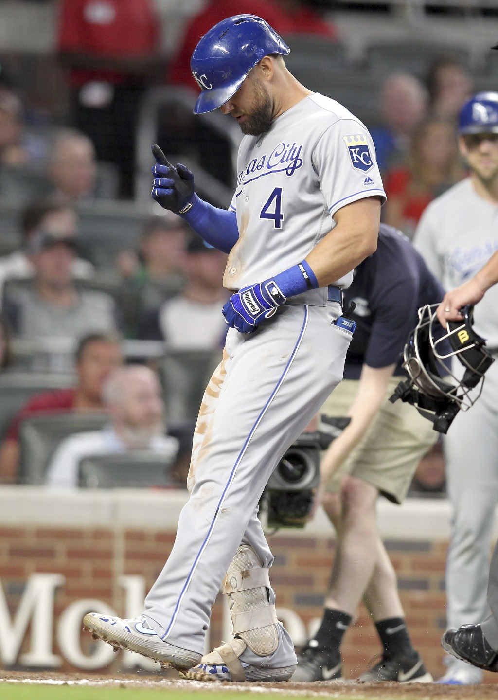 Kansas City Royals batter Alex Gordon touches home plate after a solo home run against the Atlanta Braves during the sixth inning of a baseball game T...