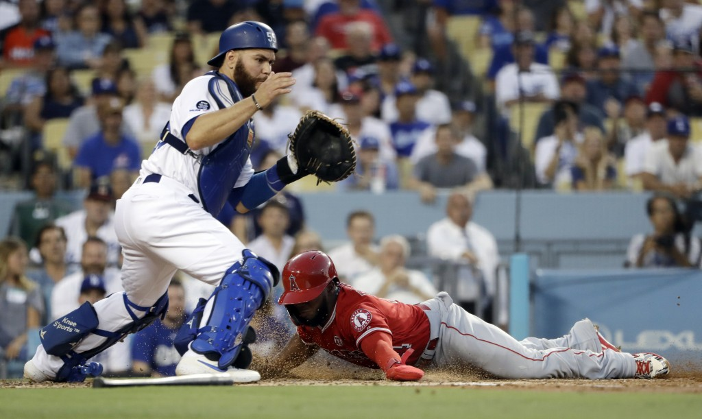 Los Angeles Angels' Luis Rengifo, right, scores past Los Angeles Dodgers catcher Russell Martin on a single by Shohei Ohtani during the second inning