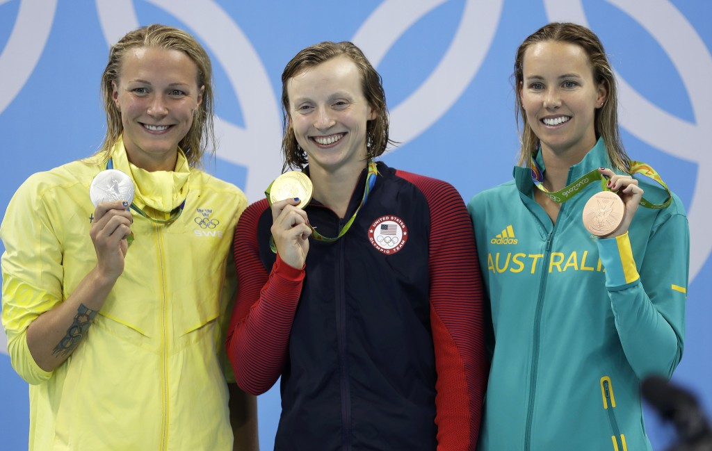 FILE - In this Aug. 9, 2016, file photo, United States' gold medal winner Katie Ledecky is flanked by Sweden's silver medal winner Sarah Sjostrom, lef...