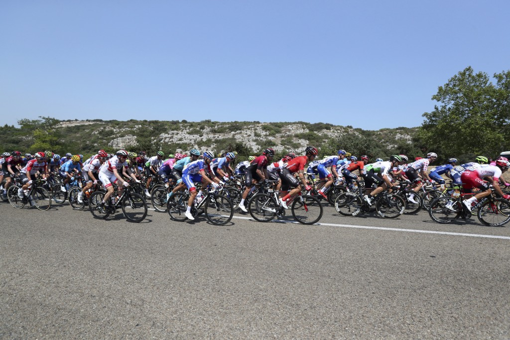 The pack rides during the seventeenth stage of the Tour de France cycling race over 200 kilometers (124,27 miles) with start in Pont Du Gard and finis...