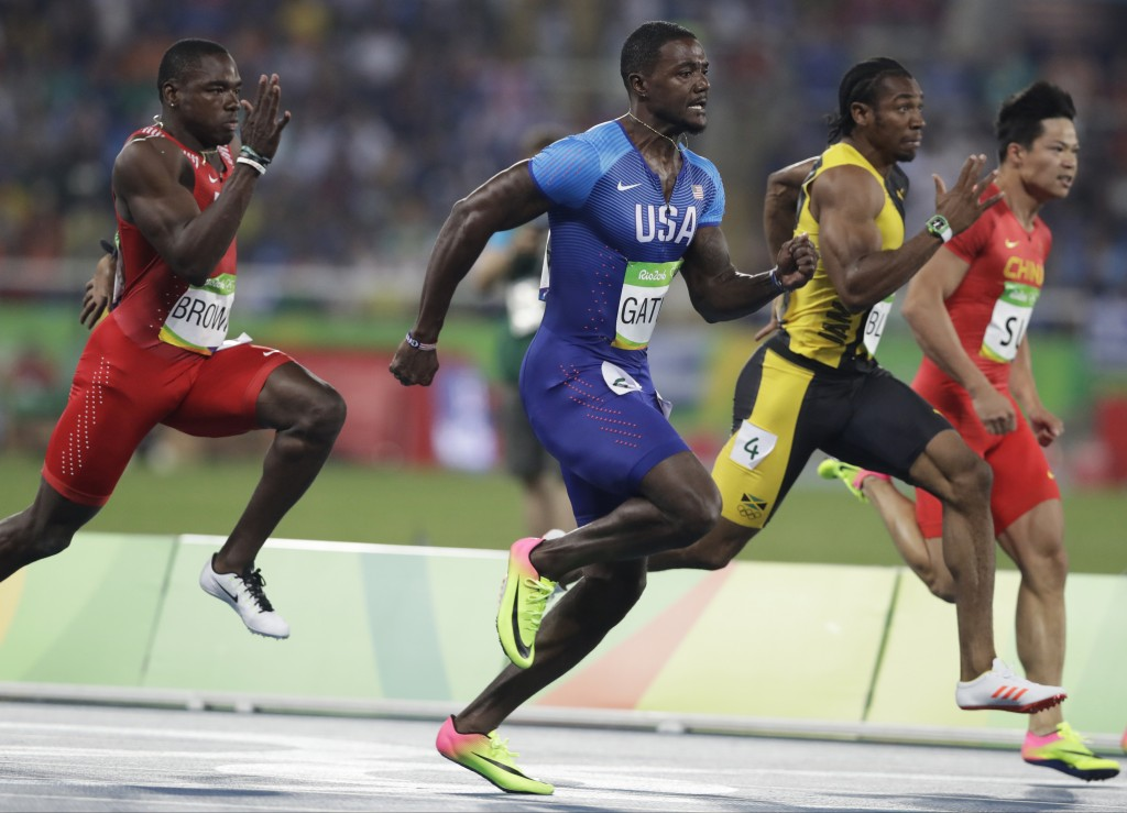 FILE - In this Aug. 14, 2016, file photo, from left, Bahrain's Kemarley Brown, United States' Justin Gatlin, Jamaica's Yohan Blake and China's Su Bing...