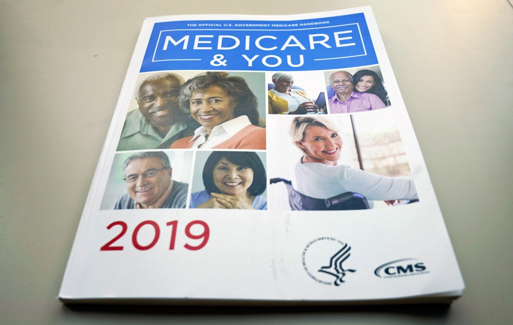 FILE - In this Nov. 8, 2018, file photo, the U.S. Medicare Handbook is photographed, in Washington. Medicare could save $1.57 for every dollar spent d...