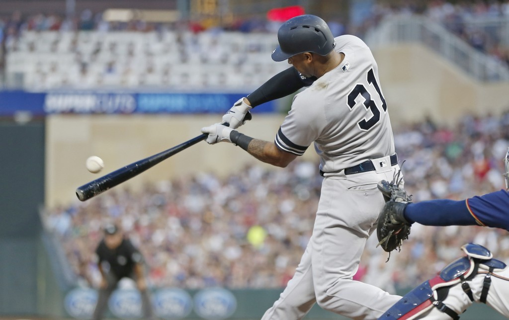 New York Yankees' Aaron Hicks hits an RBI single off Minnesota Twins pitcher Jake Odorizzi in the fourth inning of a baseball game Wednesday, July 24,...