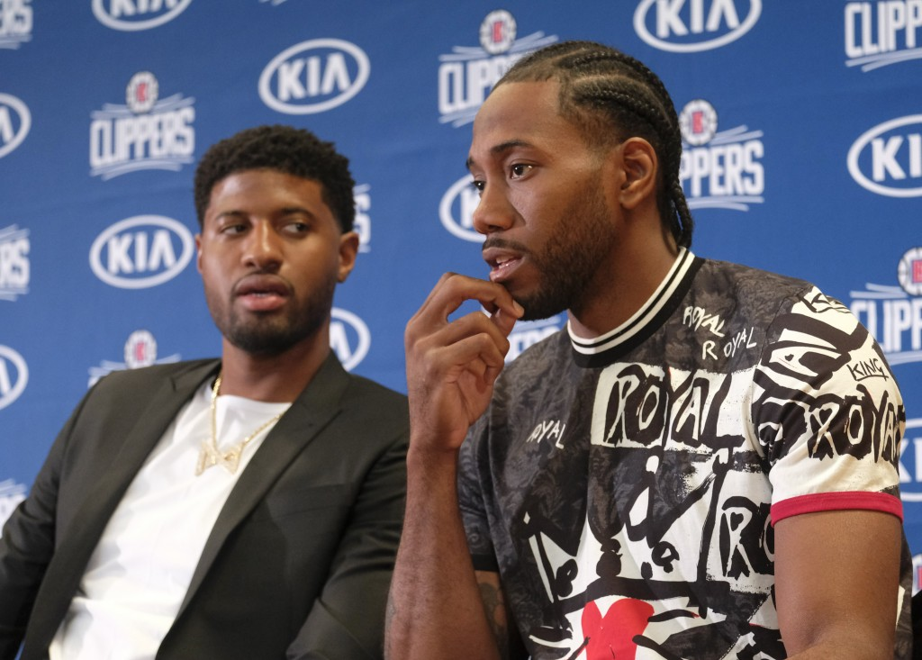 Paul George, left, and Kawhi Leonard attend a press conference  in Los Angeles, Wednesday, July 24, 2019. Nearly three weeks after the native Southern...