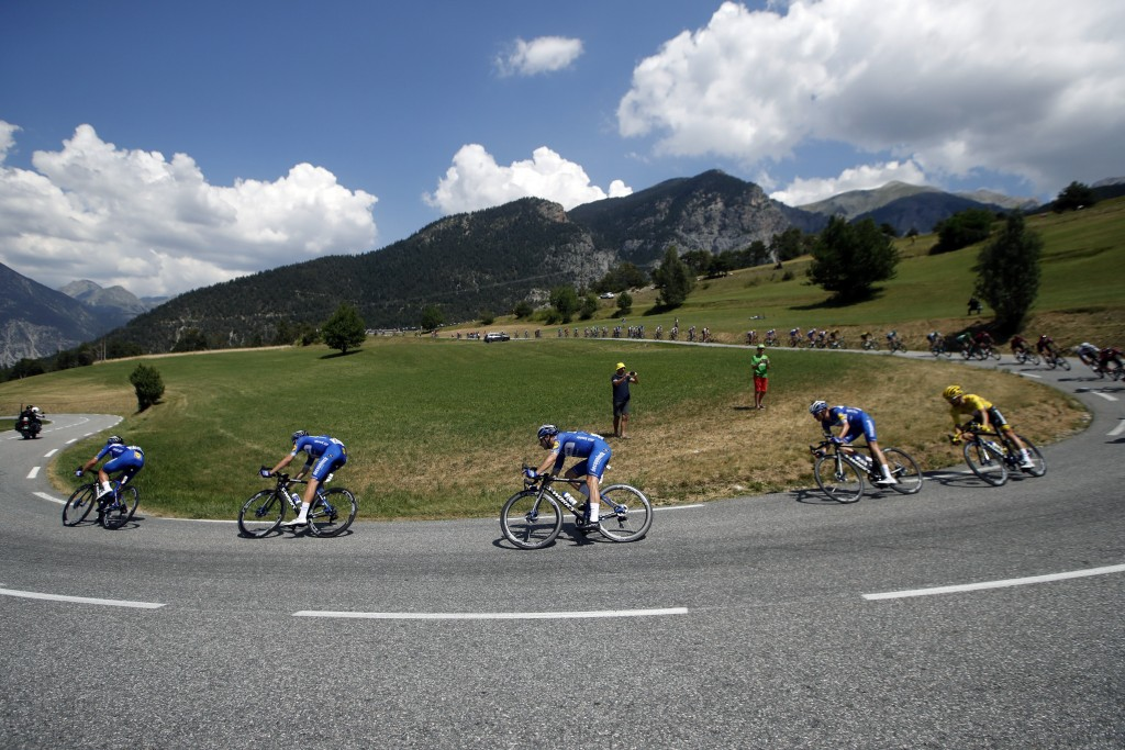 The pack rides during the eighteenth stage of the Tour de France cycling race over 208 kilometers (130 miles) with start in Embrun and finish in Vallo...