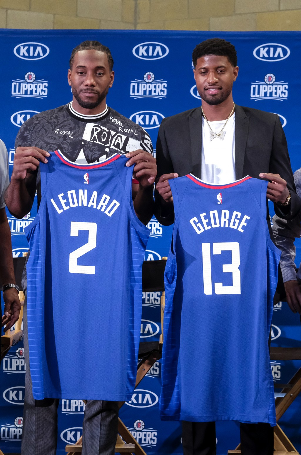Kawhi Leonard, left, and Paul George pose with their new team jerseys during a press conference in Los Angeles, Wednesday, July 24, 2019. Nearly three...