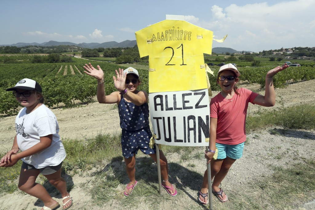 Supporters of France's Julian Alaphilippe wait for the riders during the seventeenth stage of the Tour de France cycling race over 200 kilometers (124...