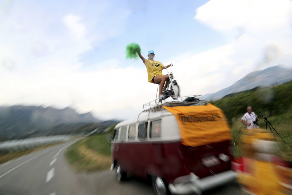A woman cheers the riders during the seventeenth stage of the Tour de France cycling race over 200 kilometers (124,27 miles) with start in Pont Du Gar...