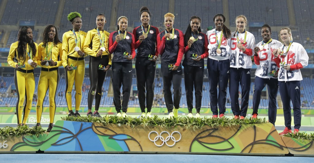FILE - In this Aug. 20, 2016, file photo, women's 4x400 meters relay teams, Jamaica, left, silver, United States, center, gold, and Great Britain, rig...