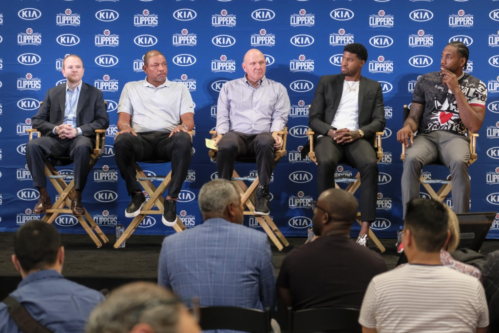 From left, Los Angeles Clippers President of Basketball Operations Lawrence Frank, head coach Doc Rivers, team chairman Steve Ballmer, Paul George and...