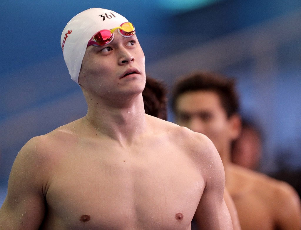 China's Sun Yang leaves the pool deck following the men's 4x200m freestyle relay heats at the World Swimming Championships in Gwangju, South Korea, Fr