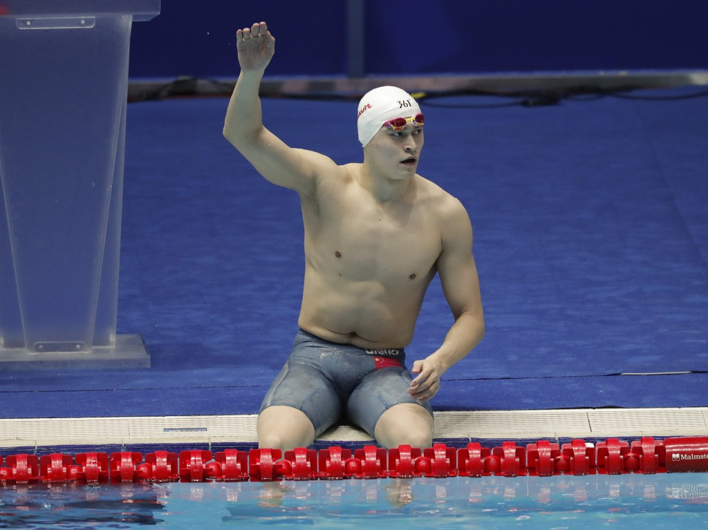 China's Sun Yang waves as he leave the pool following the men's 4x200m freestyle relay final at the World Swimming Championships in Gwangju, South Kor...