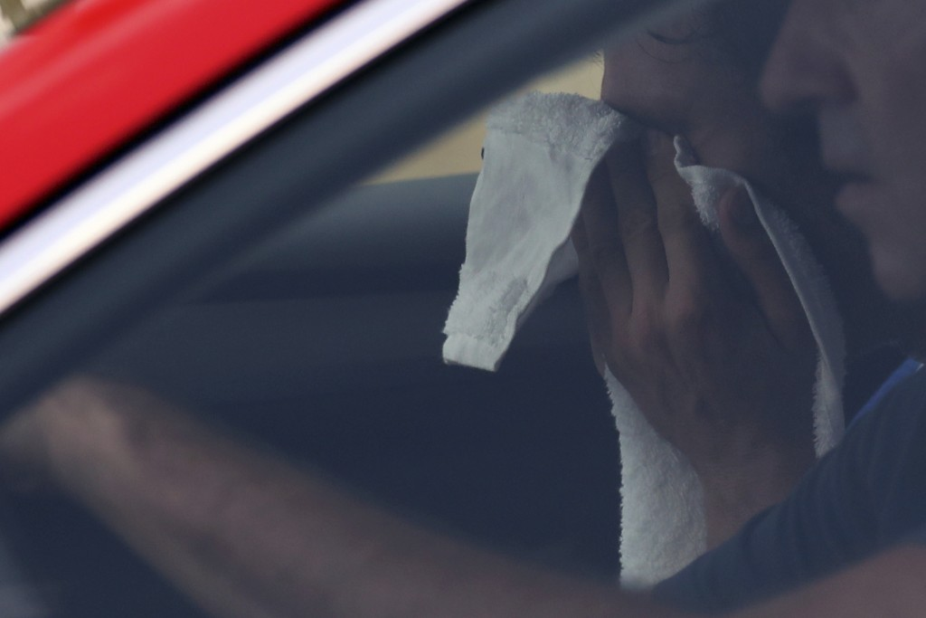 France's Thibaut Pinot wipes his face in the car of team director during the nineteenth stage of the Tour de France cycling race over 126,5 kilometers...