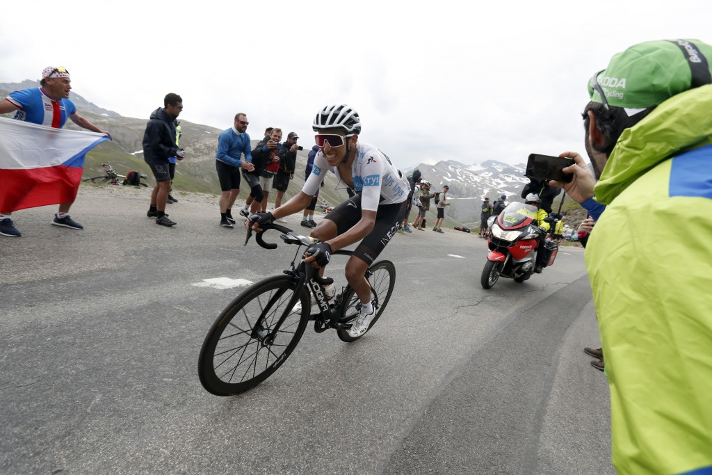 Colombia's Egan Bernal wearing the best young rider's white jersey climbs Iseran pass during the nineteenth stage of the Tour de France cycling race o...