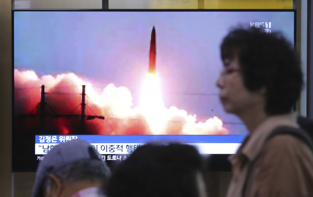A TV screen shows an image of North Korea's missile launch during a news program at the Seoul Railway Station in Seoul, South Korea, Friday, July 26, ...