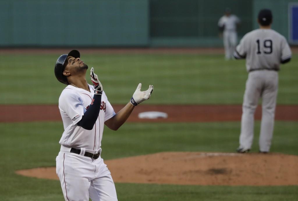 Boston Red Sox's Xander Bogaerts celebrates his three-run homer against New York Yankees starting pitcher Masahiro Tanaka (19) in the first inning of ...