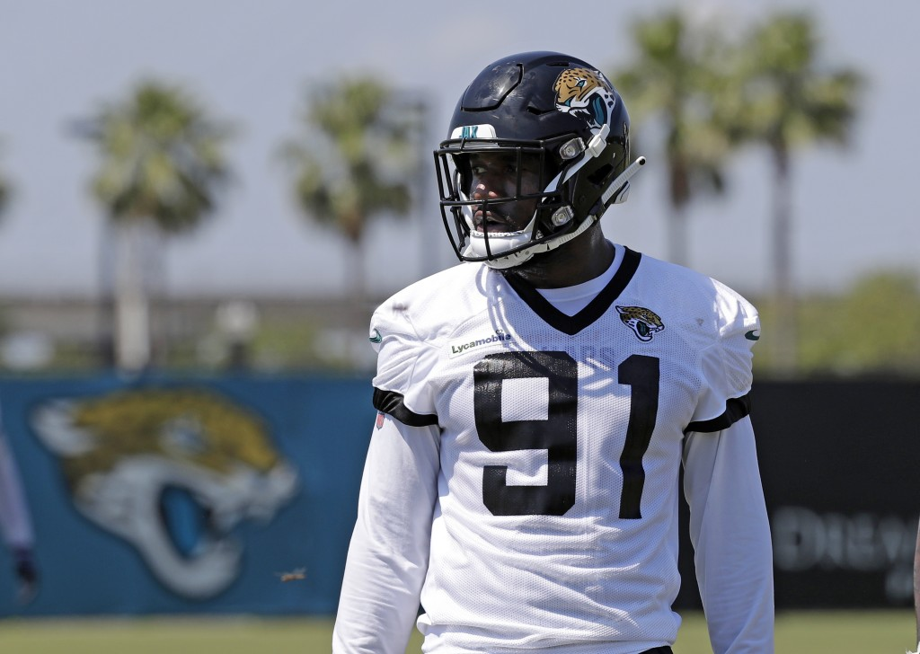 FILE - In this May 21, 2019, file photo, Jacksonville Jaguars defensive end Yannick Ngakoue (91) prepares for drills during an NFL football practice i...