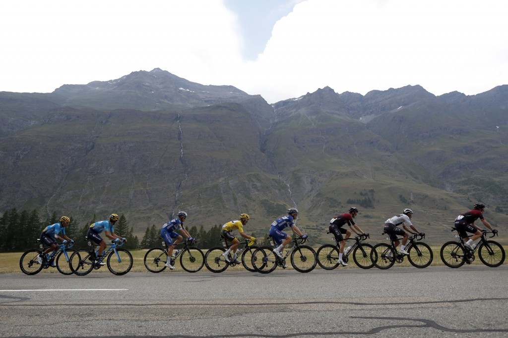 The pack with France's Julian Alaphilippe wearing the overall leader's yellow jersey rides during the nineteenth stage of the Tour de France cycling r...