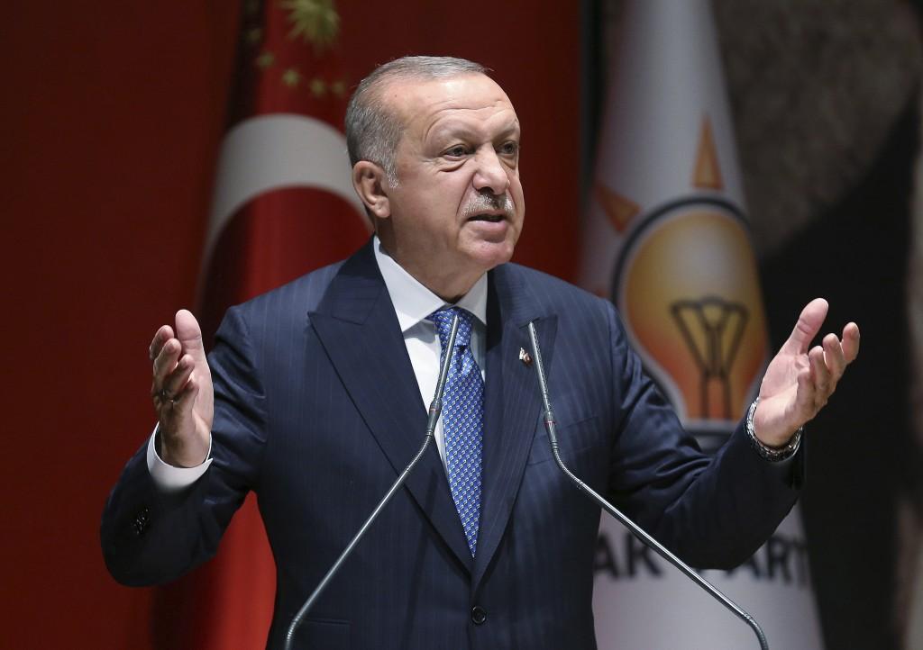 Turkey's President Recep Tayyip Erdogan addresses his ruling party members, in Ankara, Turkey, Friday, July 26, 2019. Erdogan says Turkey is determine