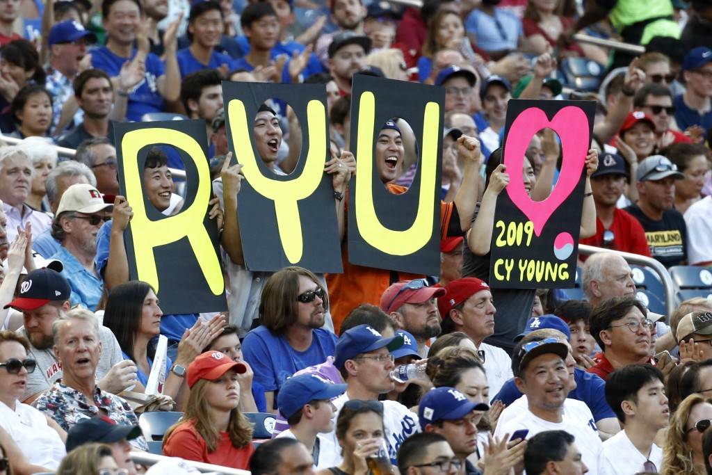 Fans hold signs for Los Angeles Dodgers starting pitcher Hyun-Jin Ryu, of South Korea, in the first inning of a baseball game between the Dodgers and ...