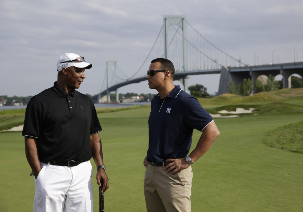 FILE- In this July 6, 2015 file photo, New York Yankee's Alex Rodriguez, right, talks with former baseball player Darryl Strawberry during a fundraise...