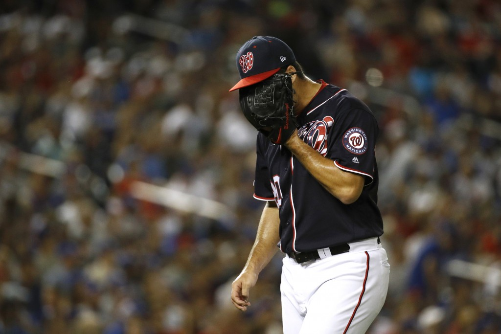 Washington Nationals relief pitcher Kyle Barraclough walks off the field after the top of the eighth inning of a baseball game against the Los Angeles...