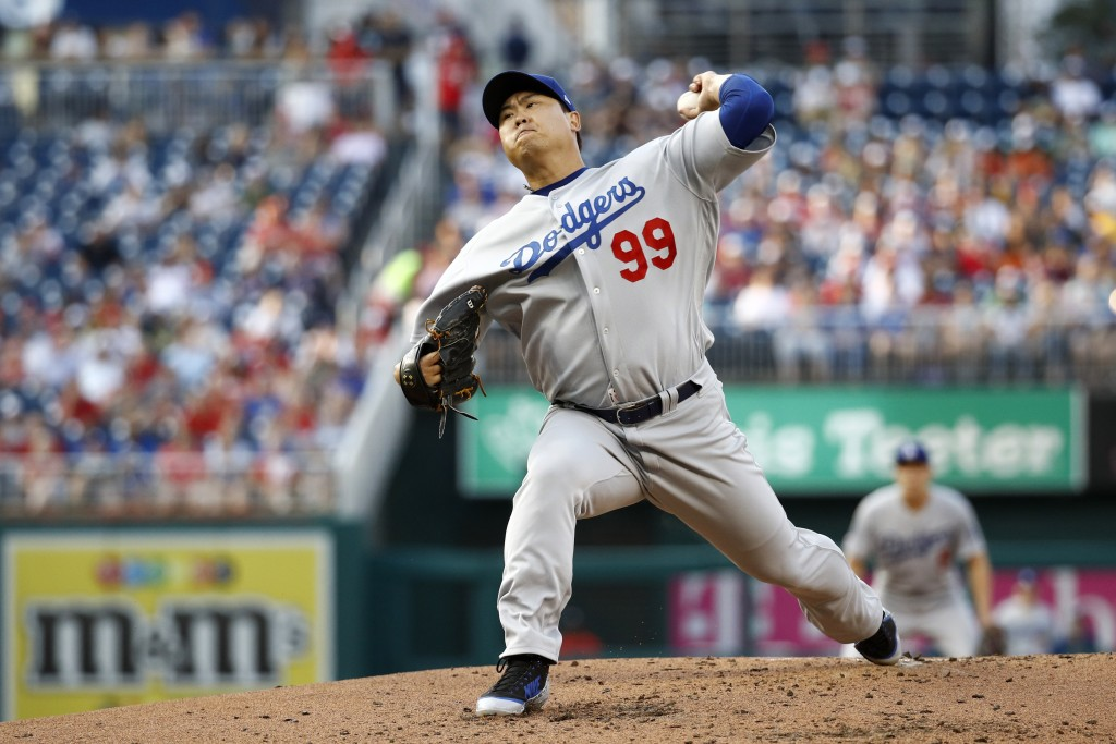 Los Angeles Dodgers starting pitcher Hyun-Jin Ryu, of South Korea, throws to the Washington Nationals in the first inning of a baseball game, Friday, ...