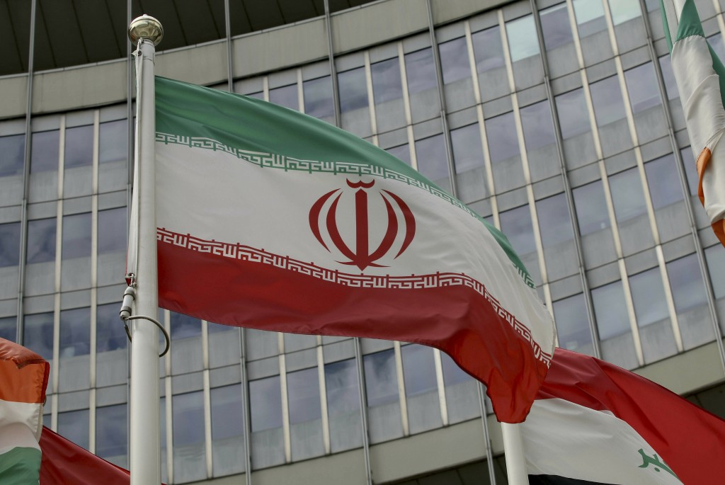 The Iranian flag waves outside of the UN building that hosts the International Atomic Energy Agency, IAEA, office inside in Vienna, Austria, Wednesday