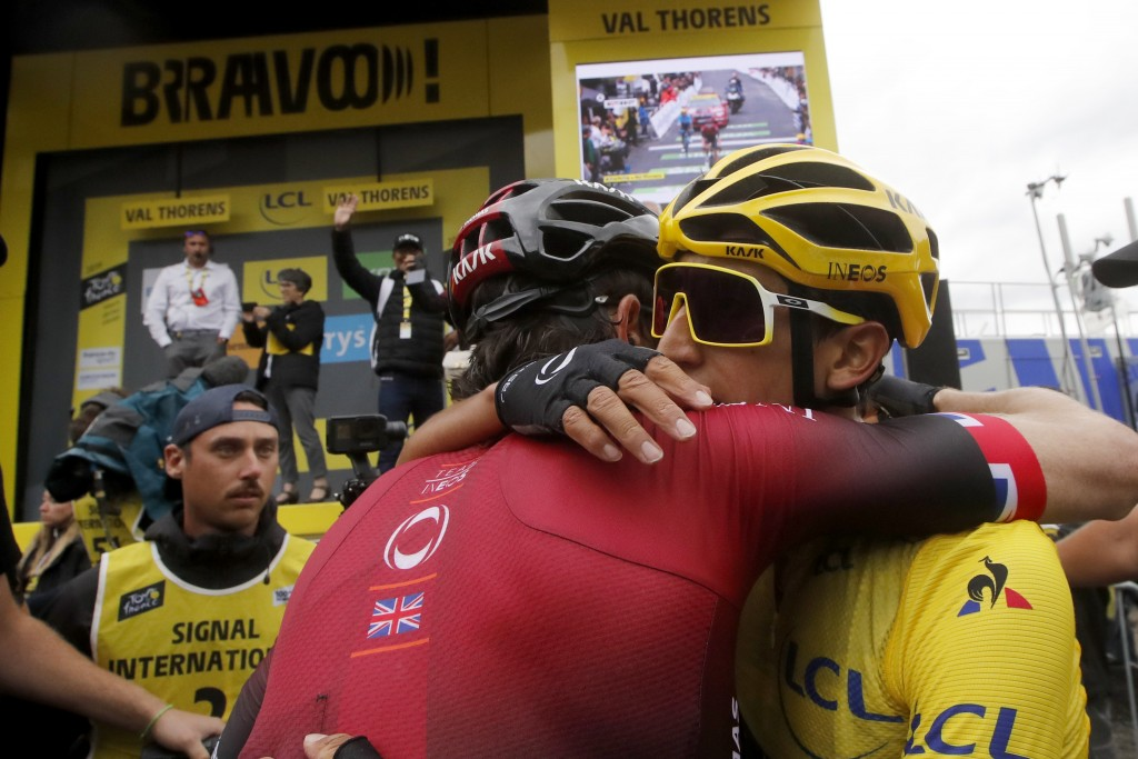 Britain's Geraint Thomas, left, congratulates Colombia's Egan Bernal wearing the overall leader's yellow jersey after the twentieth stage of the Tour ...
