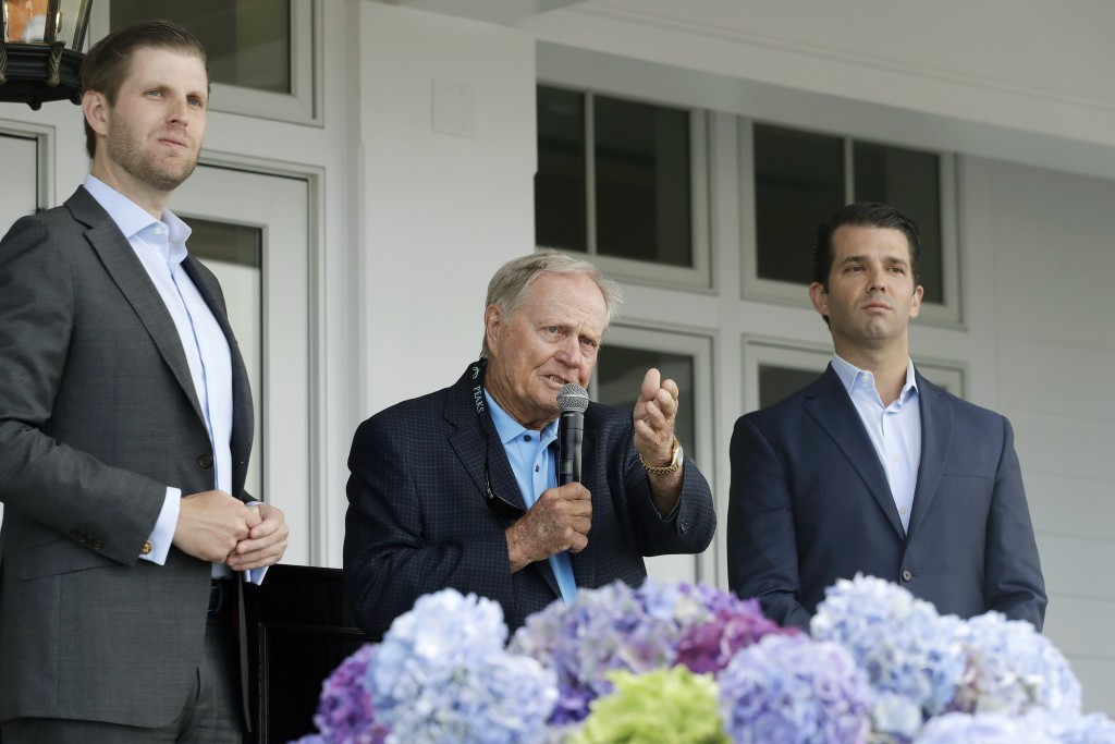 In this June 11, 2018 photo, Eric Trump, left, Jack Nicklaus, center, and Donald Trump Jr. attend the opening of the Trump Golf Links clubhouse in the...