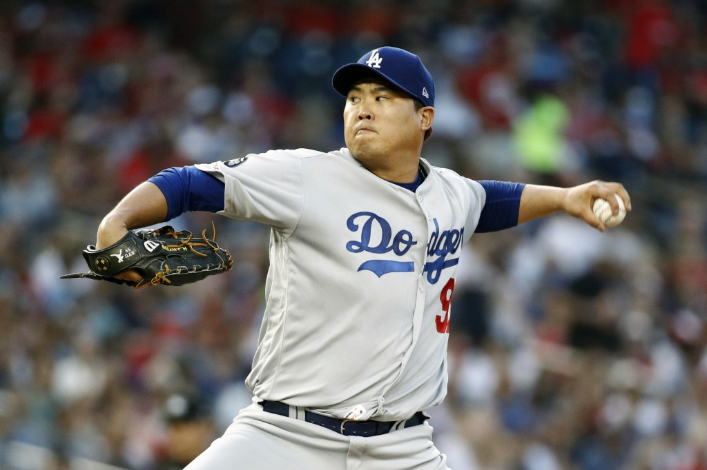 Los Angeles Dodgers starting pitcher Hyun-Jin Ryu, of South Korea, throws to the Washington Nationals in the third inning of a baseball game, Friday, ...