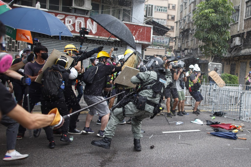 Protesters clash with police in Yuen Long district in Hong Kong on Saturday, July 27, 2019. Police in Hong Kong used tear gas against protesters Satur...