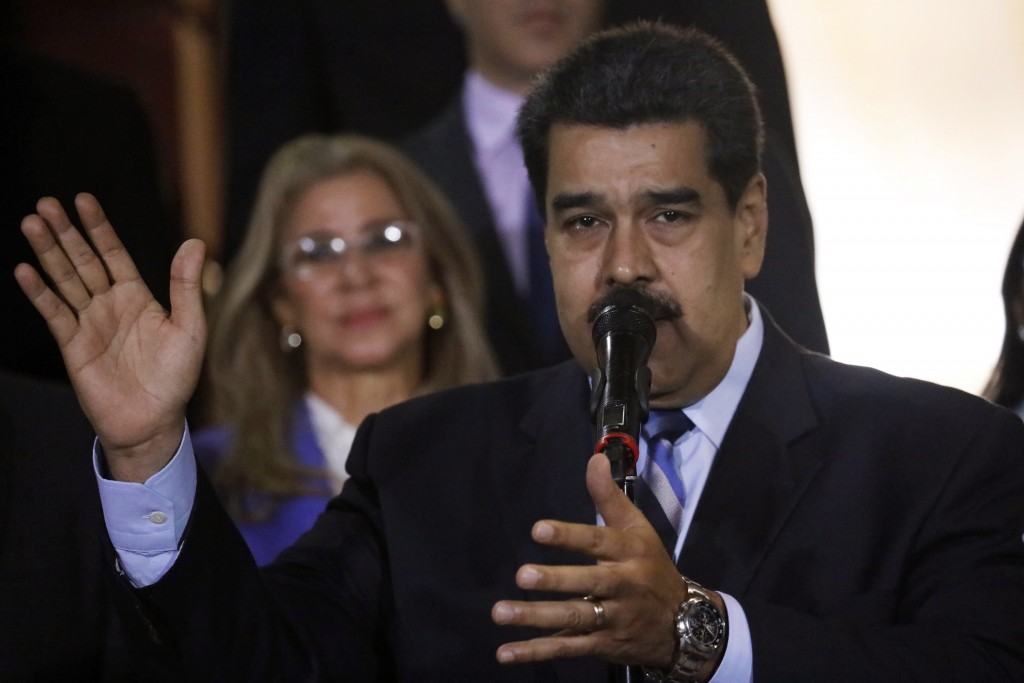 FILE - In this Friday, June 21, 2019, file photo, Venezuela's President Nicolas Maduro speaks at a news conference in Caracas, Venezuela. When much of...