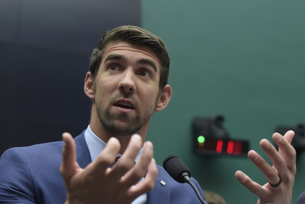FILE - In this Feb. 28, 2017, file photo, swimmer Michael Phelps testifies on Capitol Hill in Washington, before the House Commerce Energy and Commerc...