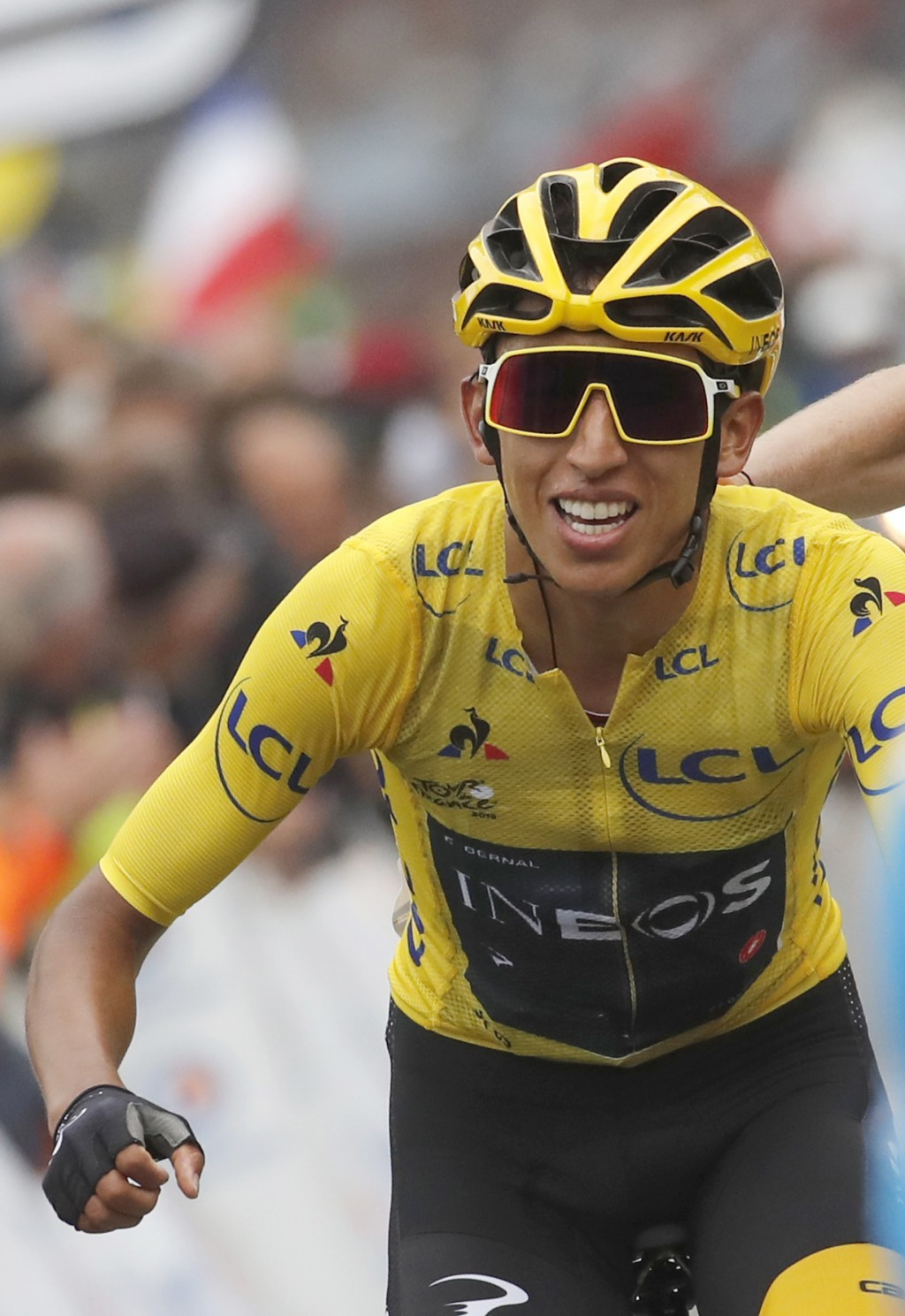 Colombia's Egan Bernal wearing the overall leader's yellow jersey celebrates as he crosses the finish line of the twentieth stage of the Tour de Franc...