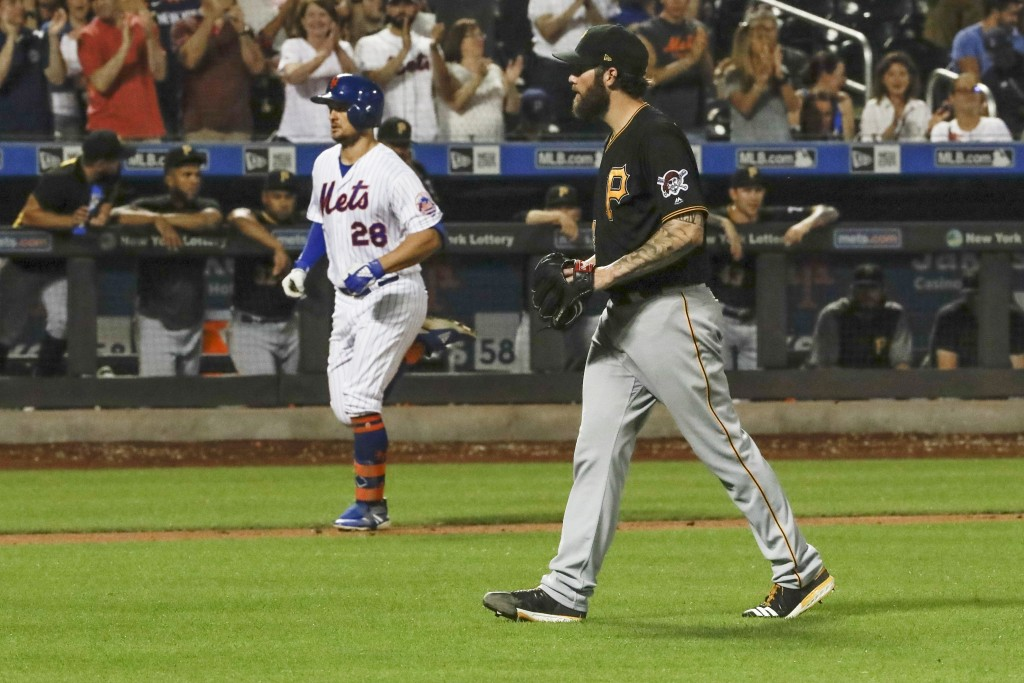 Pittsburgh Pirates starting pitcher Trevor Williams, right, reacts as New York Mets' J.D. Davis heads to home plate to score on a two-run home run dur...