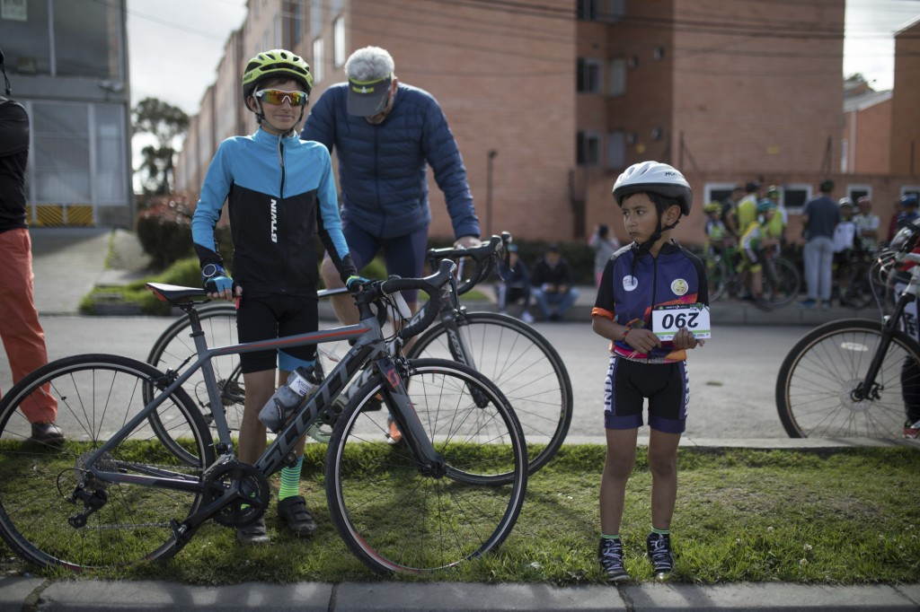 Cyclers gather to watch on a giant screen Colombia's Egan Bernal performance in the twentieth stage of the Tour de France cycling race at Bernal's hom...