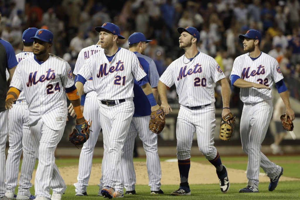 New York Mets starting pitcher Steven Matz (32) celebrates with teammates Pete Alonso (20), Todd Frazier (21) and Robinson Cano (24) after a baseball ...