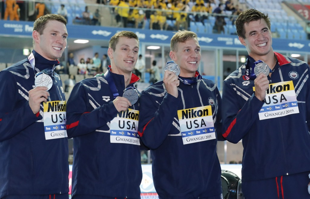 The United States men's 4x100m medley relay team, from left, Ryan Murphy, Andrew Wilson, Caeleb Dressel and Nathan Adrian pose with their silver medal