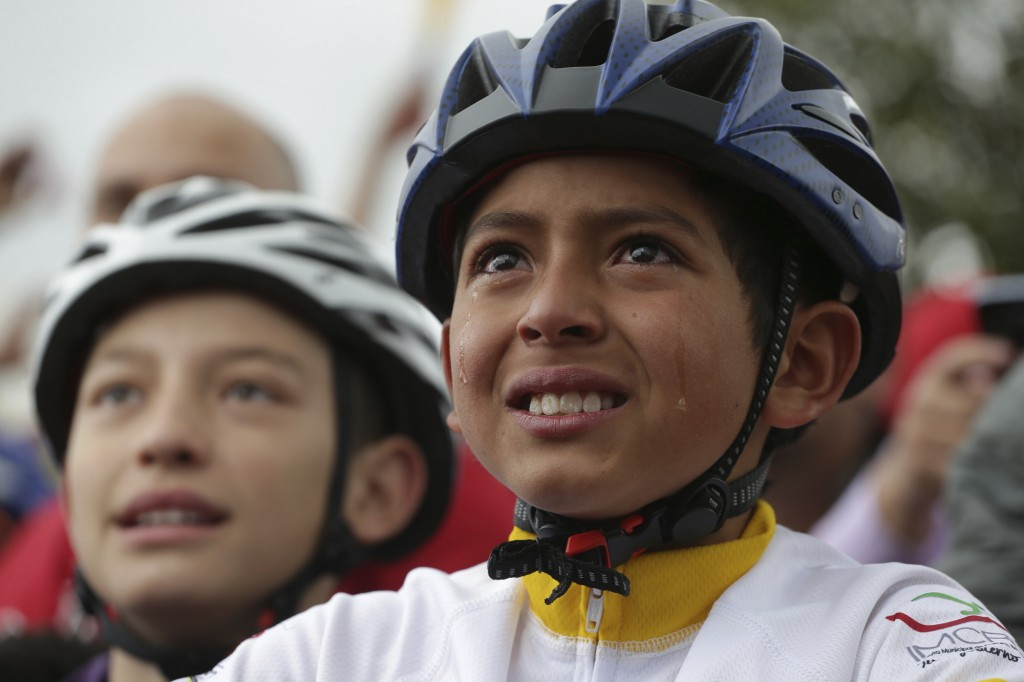 Tears run down the face of a boy watching on a giant screen Colombia's Egan Bernal performance in the twentieth stage of the Tour de France cycling ra...