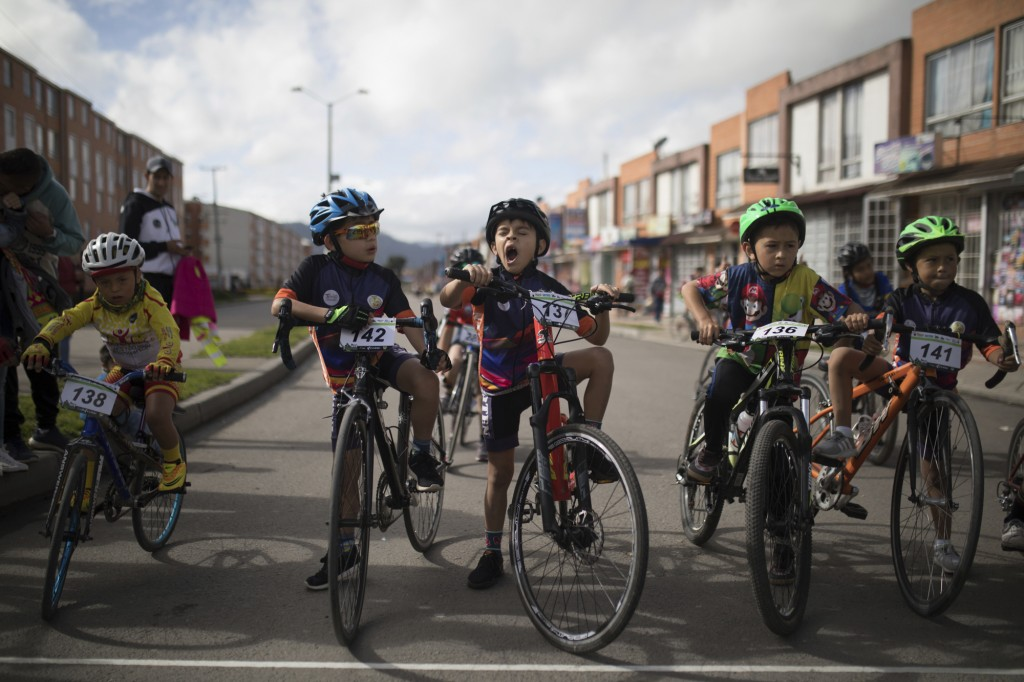 Cyclers line up to take part in a race organized in the home town of Colombia's Egan Bernal to celebrate his performance in the twentieth stage of the...