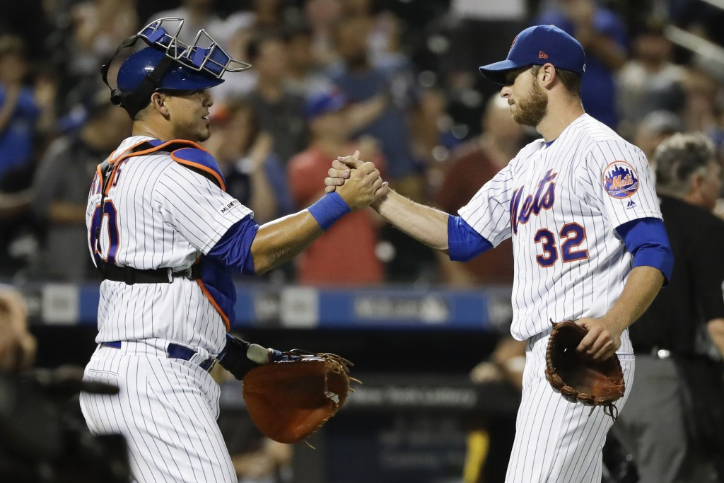 New York Mets starting pitcher Steven Matz, right, celebrates with catcher Wilson Ramos after a baseball game against the Pittsburgh Pirates, Saturday