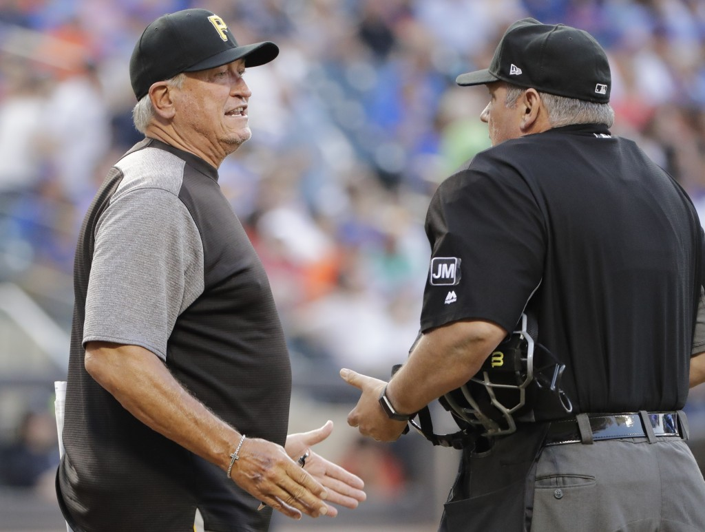 Pittsburgh Pirates manager Clint Hurdle argues with home plate umpire Hunter Wendelstedt during the first inning of a baseball game Saturday, July 27,...
