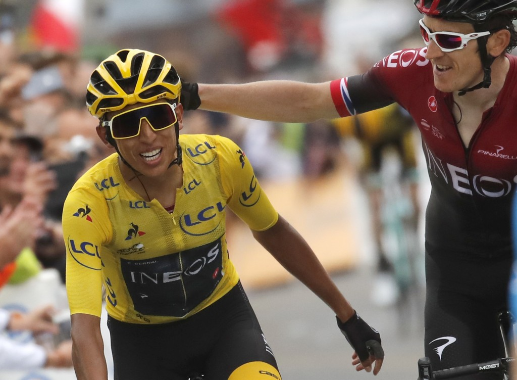 Britain's Geraint Thomas, right, congratulates Colombia's Egan Bernal wearing the overall leader's yellow jersey as they crosses the finish line of th...