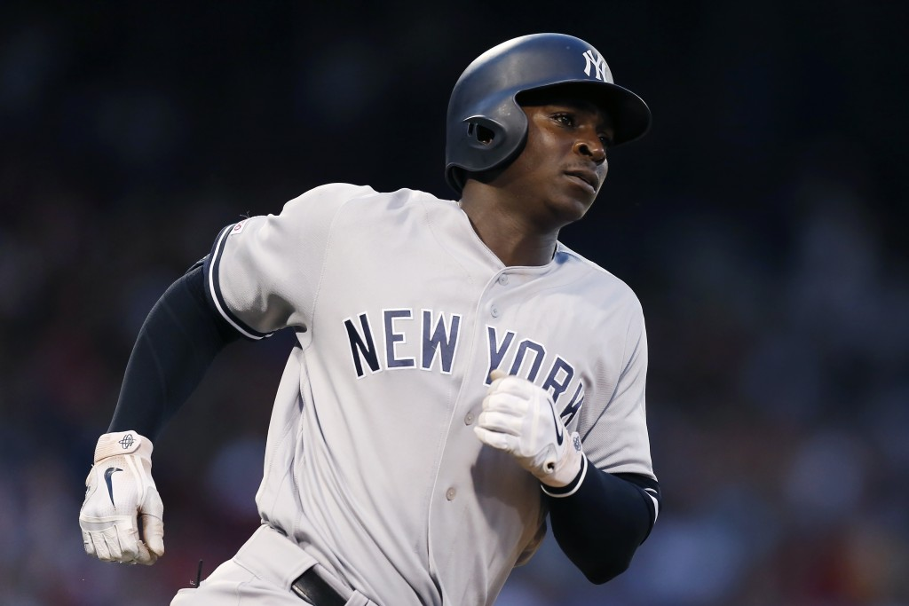 New York Yankees' Didi Gregorius runs on his two-run home run during the fourth inning of a baseball game against the Boston Red Sox in Boston, Sunday...