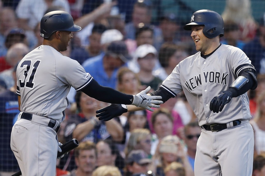 New York Yankees' Austin Romine, right, celebrates his two-run home run with Aaron Hicks (31) during the third inning of a baseball game against the B...