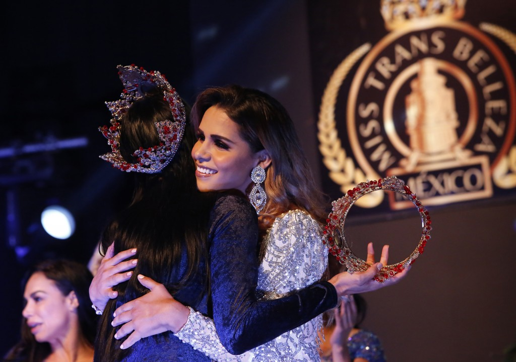 Brenda Contreras, Miss Transgender Beauty 2018, left, embraces 2019 winner Ivanna Cázares, from Colima state, in Mexico City, Saturday, July 27, 2019....
