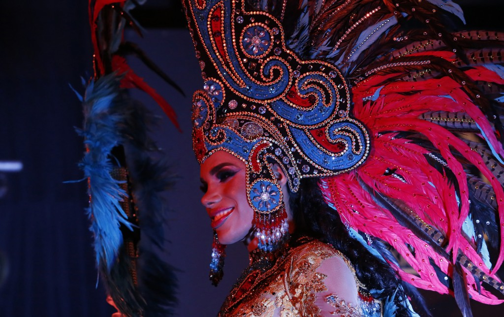 A contestant in the Miss Transgender Beauty pageant from the state of Sonora wears regional costume to be judge during the event in Mexico City, Satur...